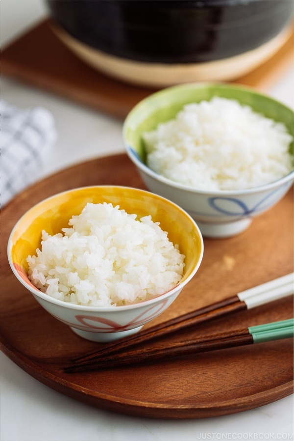 Perfectly cooked steamed rice served in Japanese rice bowls.