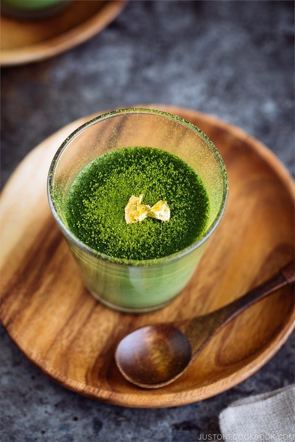 Matcha Vegan Panna Cotta served in a glass bowl, topped with gold flakes!