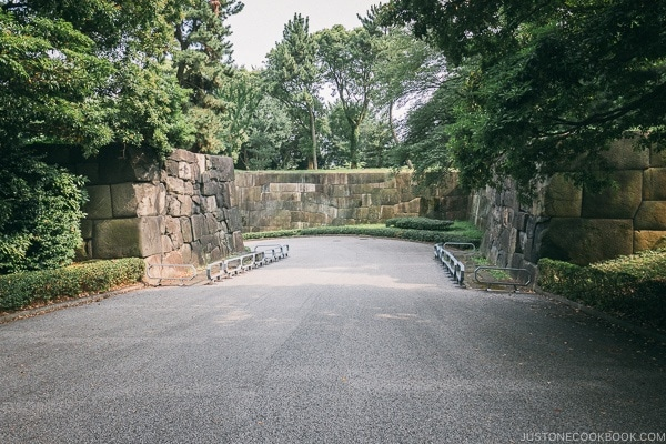 walkway surrounded by stone walls - The East Gardens of the Imperial Palace Guide | www.justonecookbook.com