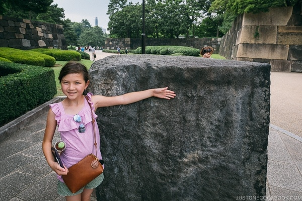 Just One Cookbook child in front of large stone to built castle wall - The East Gardens of the Imperial Palace Guide | www.justonecookbook.com