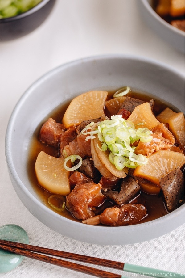 A grey dish containing Japanese beef tendon stew.