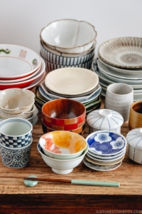 Selection of Japanese tableware including plates and bowls on a table.
