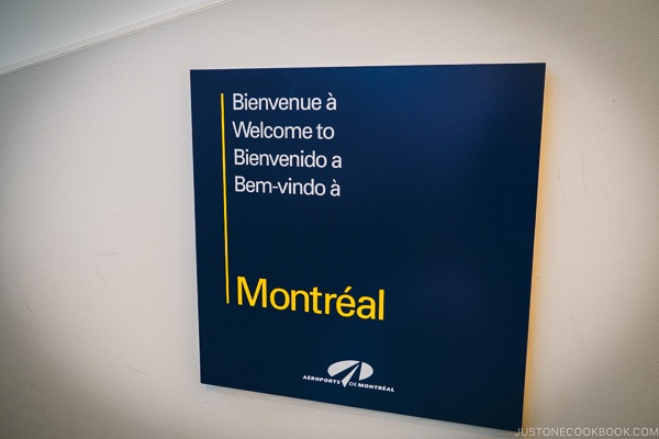 Welcome to Montreal sign at the airport - Montreal Travel Guide | www.justonecookbook.com