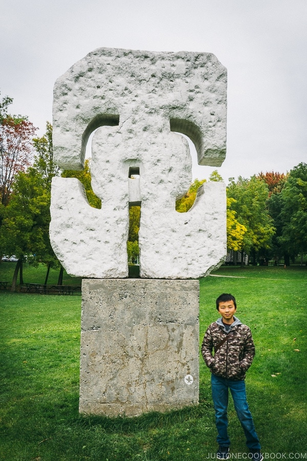 child standing next to sculpture at Mount Royal Park - Montreal Travel Guide | www.justonecookbook.com