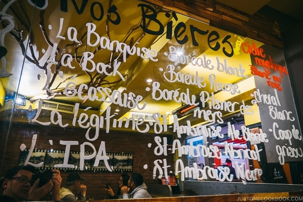 beer names on a mirror at La Banquise - Montreal Travel Guide   www.justonecookbook.com