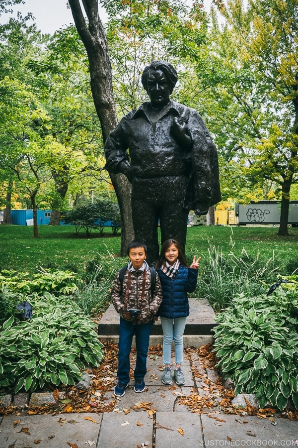 Just One Cookbook children in front of Statue de Félix Leclerc at Parc La Fontaine - Montreal Travel Guide | www.justonecookbook.com