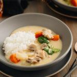 A gray bowl containing Japanese Cream Stew (White Stew) with chicken and vegetables in a savory thick white sauce.