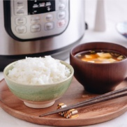 Perfectly cooked rice served in a rice bowl along with miso soup.