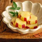 Fluted bowl containing Simmered Japanese Sweet Potatoes with Lemon.