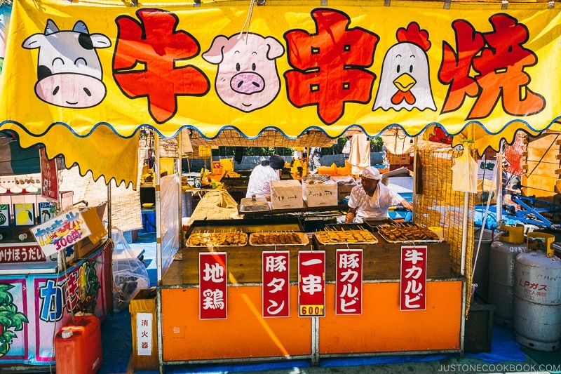 summer festival food stall vendor selling meat skewers - Tokyo Asakusa Travel Guide | www.justonecookbook.com