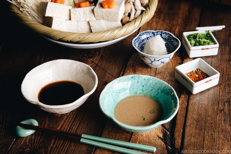 Ponzu sauce and sesame sauce are served for shabu shabu (Japanese hot pot) meal. Garnish with grated daikon, green onion, or Japanese chili peppers.