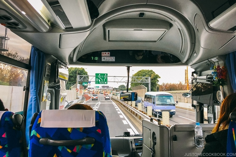 looking through the bus windshield at the freeway ahead - Hakuba Travel and Ski Guide | www.justonecookbook.com