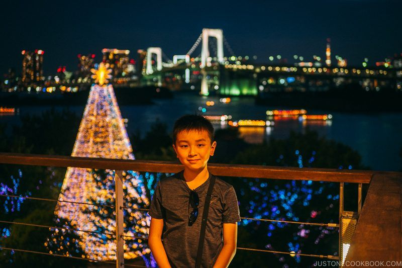 child in Odaiba in front of Rainbow Bridge at night - Tokyo Odaiba Travel Guide | www.justonecookbook.com