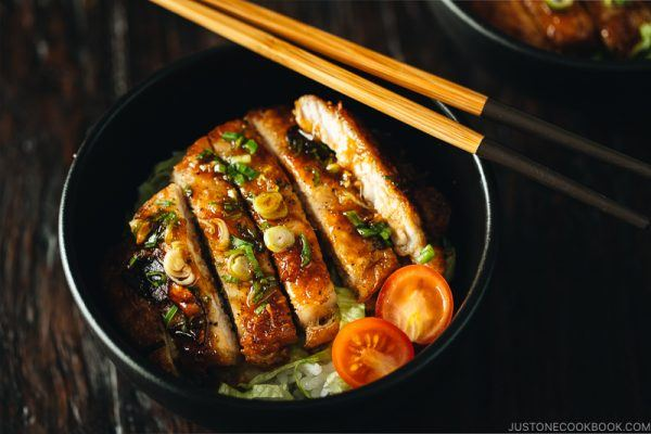 teriyaki pork in a black bowl