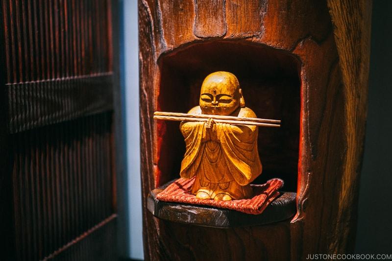 wooden buddha statue - Restaurant Den Tokyo | www.justonecookbook.com