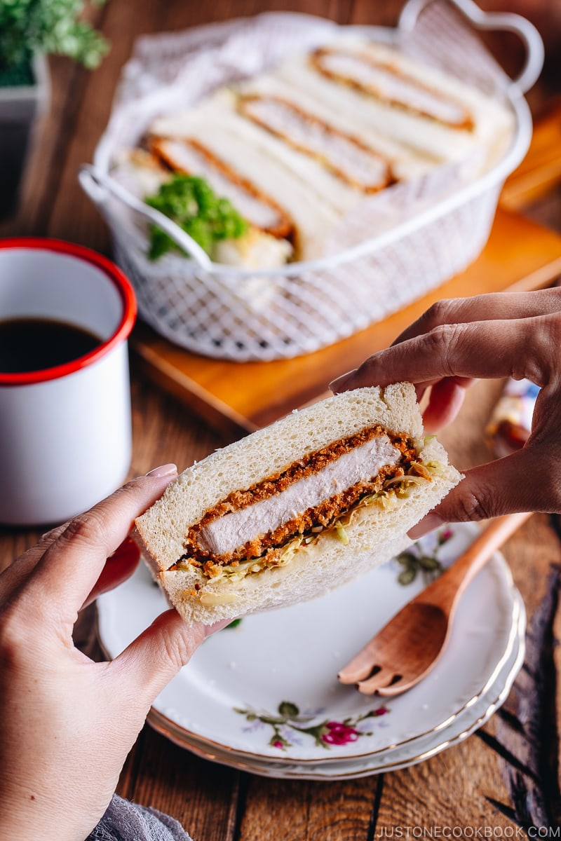 Katsu Sando held between hands and about to be enjoyed.