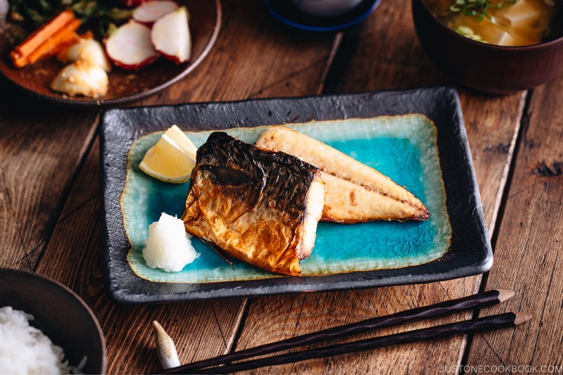 Grilled mackerel (saba shioyaki) on a Japanese style plate, served with miso soup, rice and pickles.