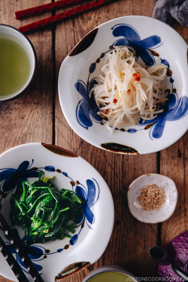 Spinach Namul and Bean Sprout Namul in blue flower pattern dishes