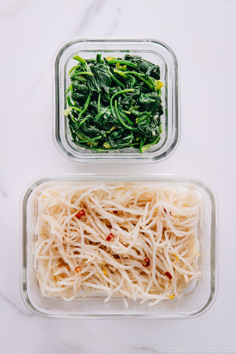 Spinach and Bean Sprout Namul in glass containers.