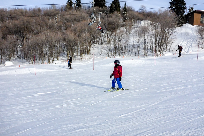 child skiing down the hill at Snowbasin Resort - Ski Vacation Planning in Utah | www.justonecookbook.com