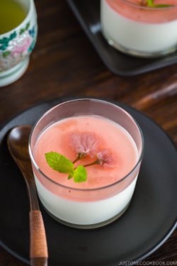Cherry blossom milk pudding in a glass.