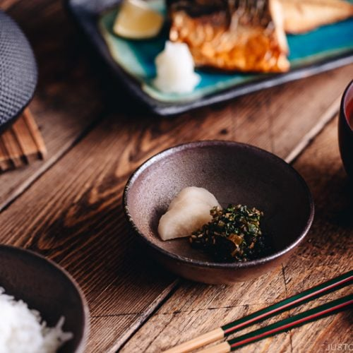 Japanese meal set with daikon leaves furikake and pickles in a small plate.