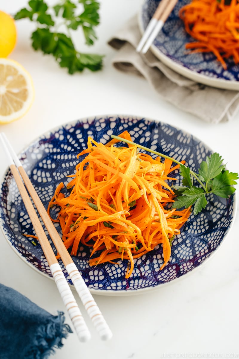 Carrot salad on a blue plate.