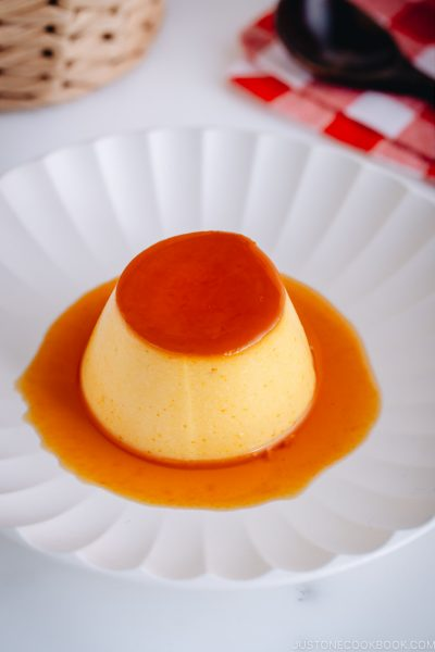 Silky soft and creamy Instant Pot Kabocha Flan on a white plate.