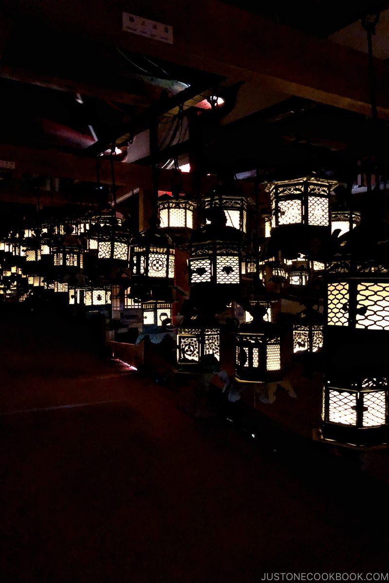 lit lanterns at Fujinami-no-ya Hall - Nara Guide: Kasuga-taisha | www.justonecookbook.com