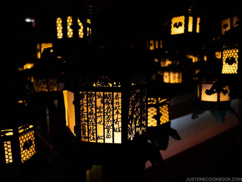 lit lanterns inside Fujinami-no-ya Hall - Nara Guide: Kasuga-taisha | www.justonecookbook.com
