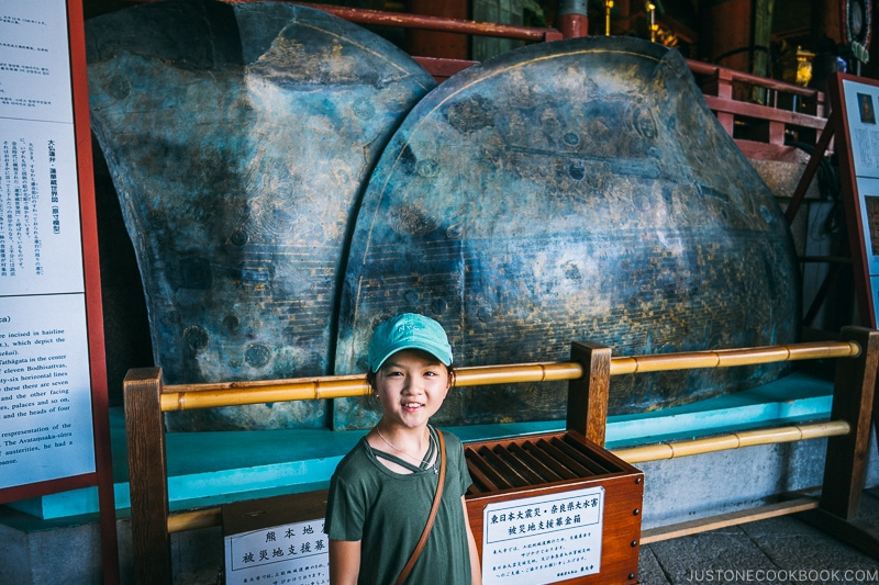 child standing in front of lotus petal replicate inside Daibutsuden - Nara Guide: Todaiji | www.justonecookbook.com