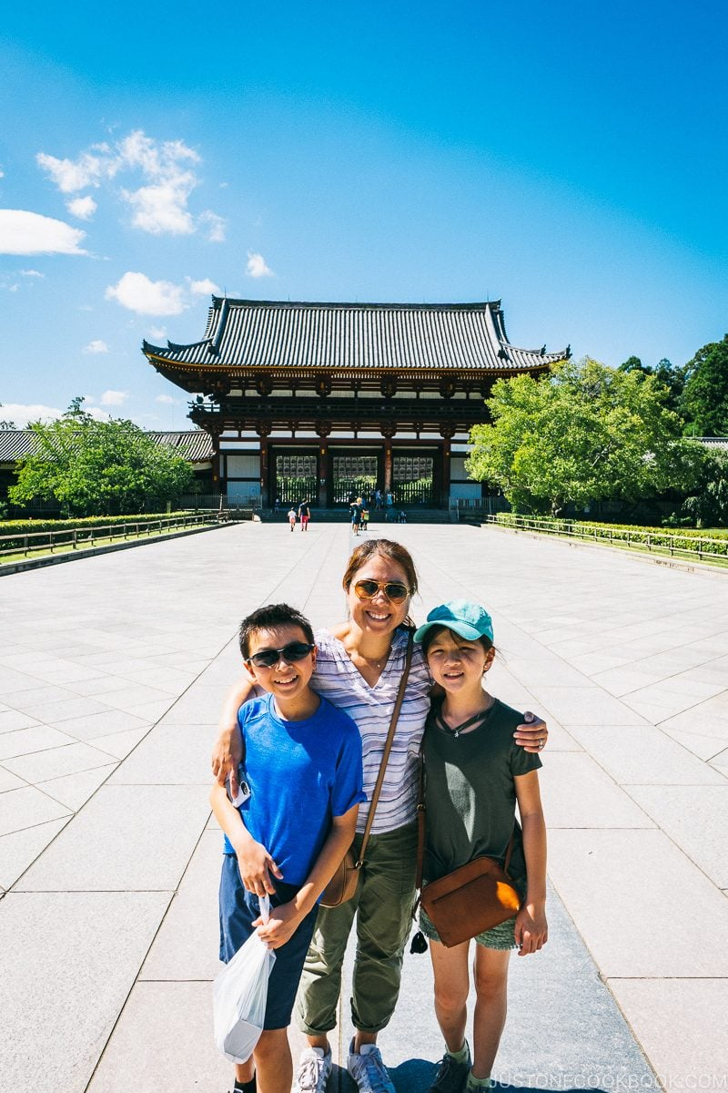 Two female and a male in front of Todaiji