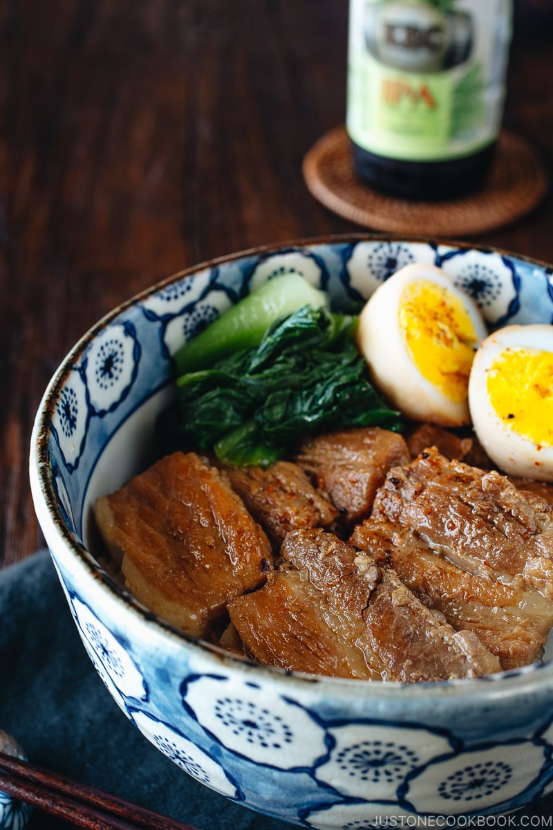 Pressure cooker kakuni (Instant Pot Japanese Pork Belly) served over rice along with eggs and greens in donburi bowl.