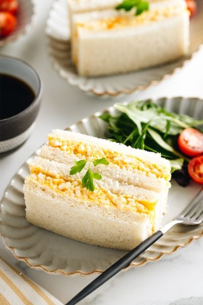 Tamago Sando - Japanese Egg Salad Sandwich on a plate along with salad.
