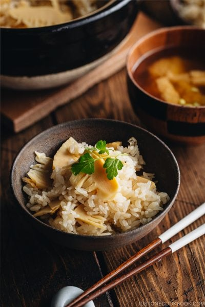 Bamboo rice in a bizen Japanese rice bowl and in a donabe (Japanese clay pot).