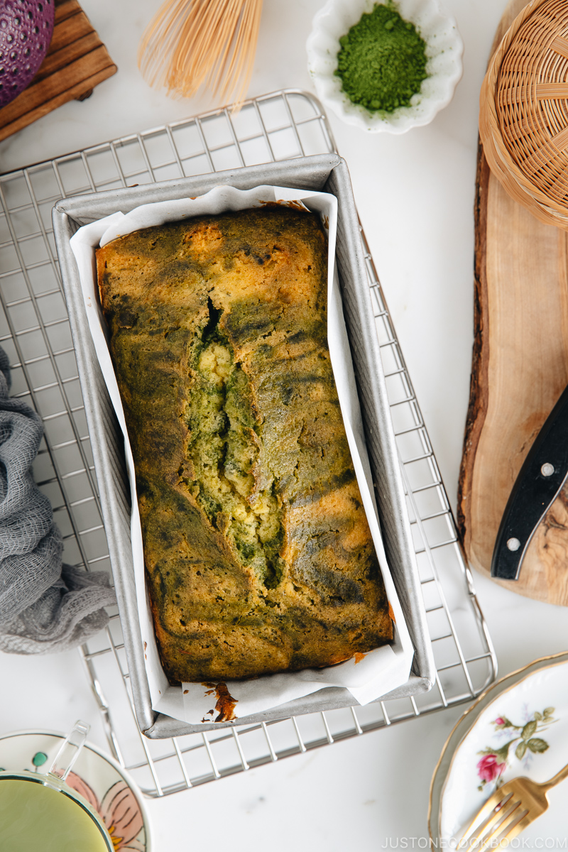 Matcha marble pound cake in a loaf pan.