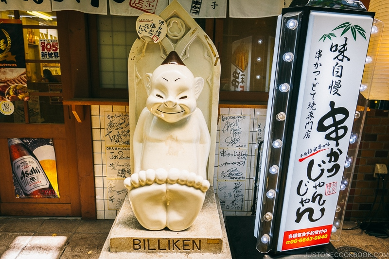 Billiken statue in front of a restaurant - Osaka Guide: Tsutenkaku and Shinsekai District | www.justonecookbook.com