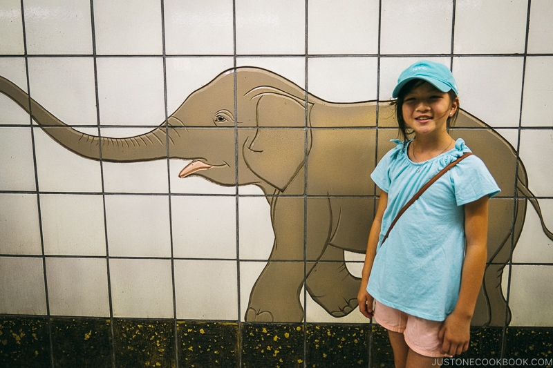 child standing in front of an elephant made of tiles - Osaka Guide: Tsutenkaku and Shinsekai District | www.justonecookbook.com