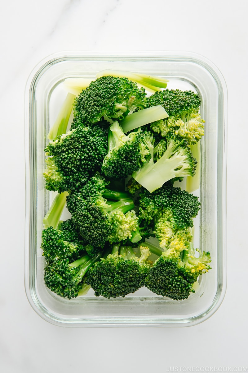 Blanched broccoli in the glass container.