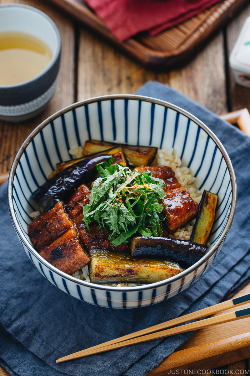Eggplant & Unagi Over Rice in a Japanese blue and white bowl.