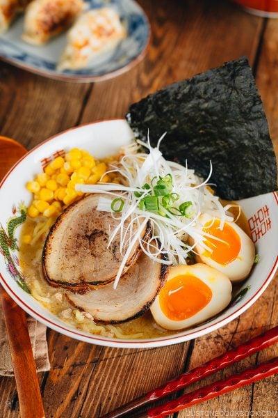 Miso ramen with homemade chashu and ramen egg garnished with nori.