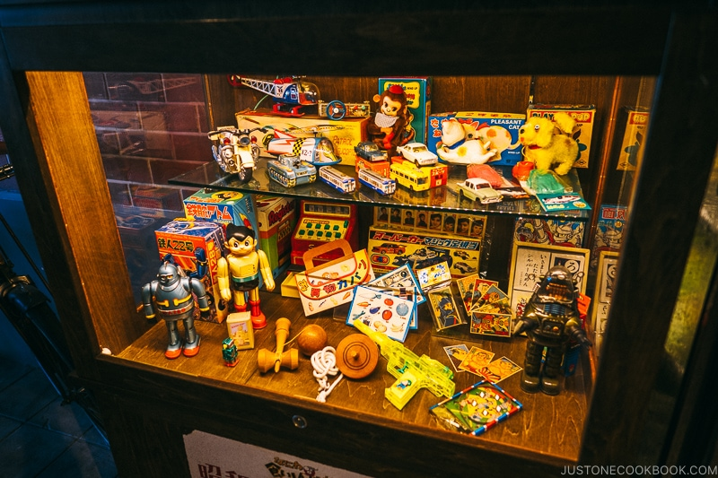Japanese toys from 1960s inside display case at Naniwa Kushinbo Yokocho - Osaka Guide: Tempozan Harbor Village | www.justonecookbook.com