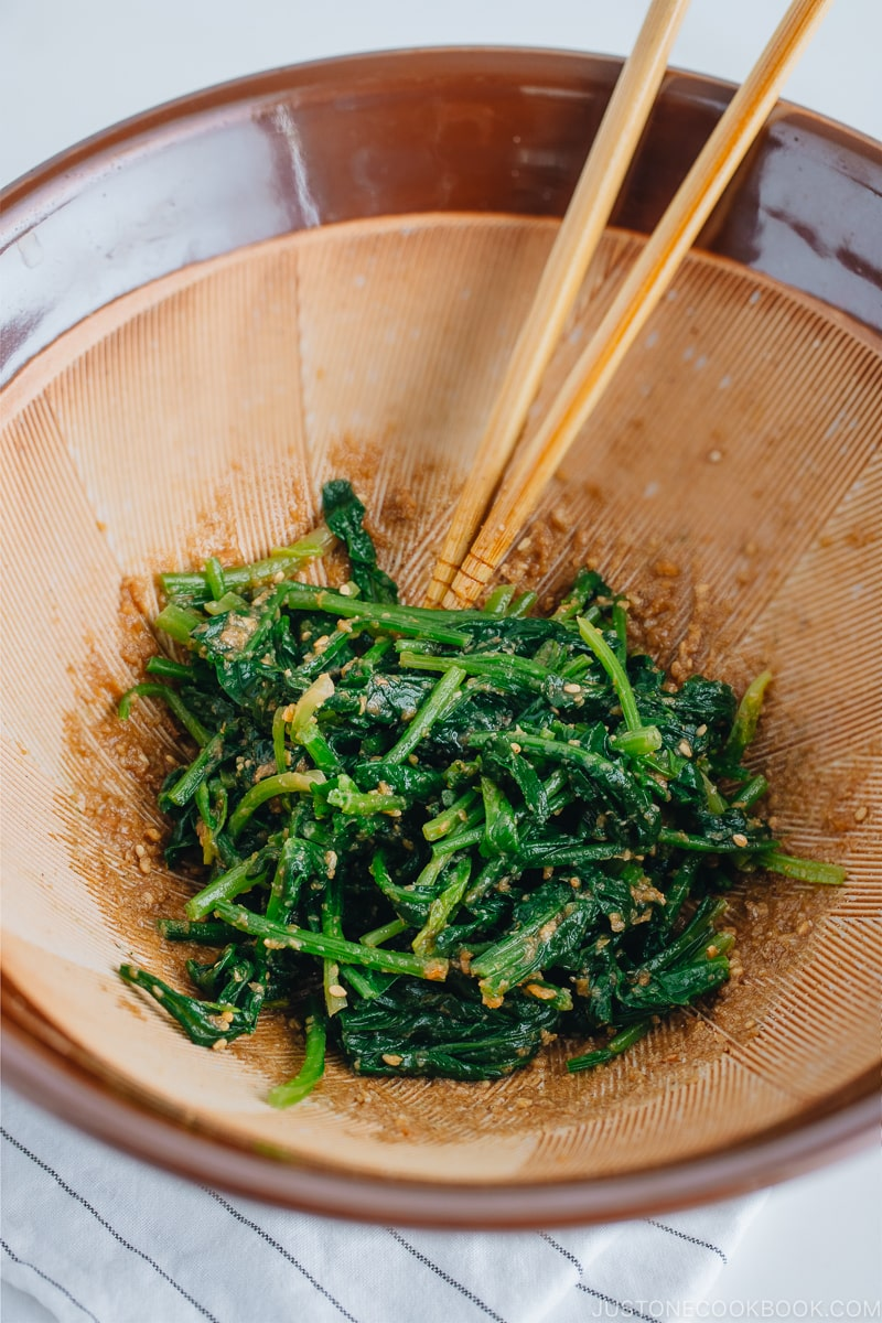 Spinach with sesame miso sauce in a Japanese mortar and pestle.