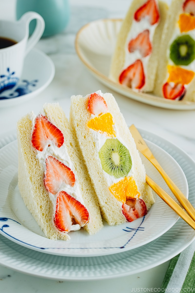 Japanese fruit sandwiches on a plate. Served with coffee.