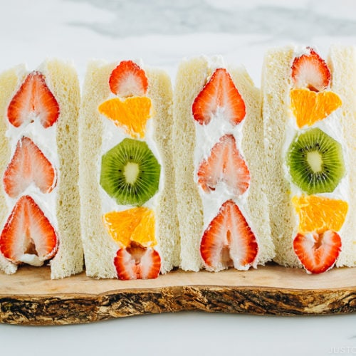Japanese Fruit Sandwiches on a wooden board.