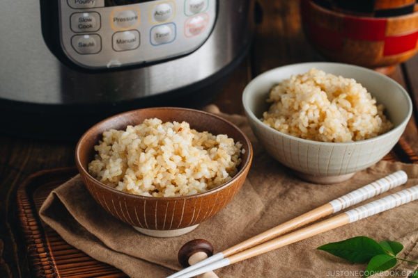 Rice bowls containing perfectly cooked short grain brown rice.
