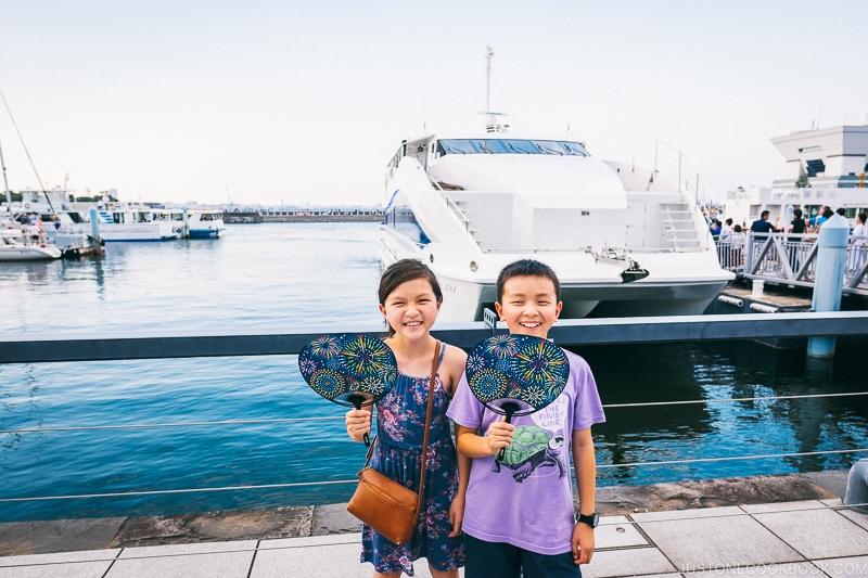 children in front of a boat at Yokohama pier - Japan's Fireworks Hanabi | www.justonecookbook.com