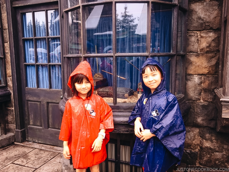 children in front of wands inside a window at the Wizarding World of Harry Potter - Osaka Guide: Universal Studios Japan | www.justonecookbook.com