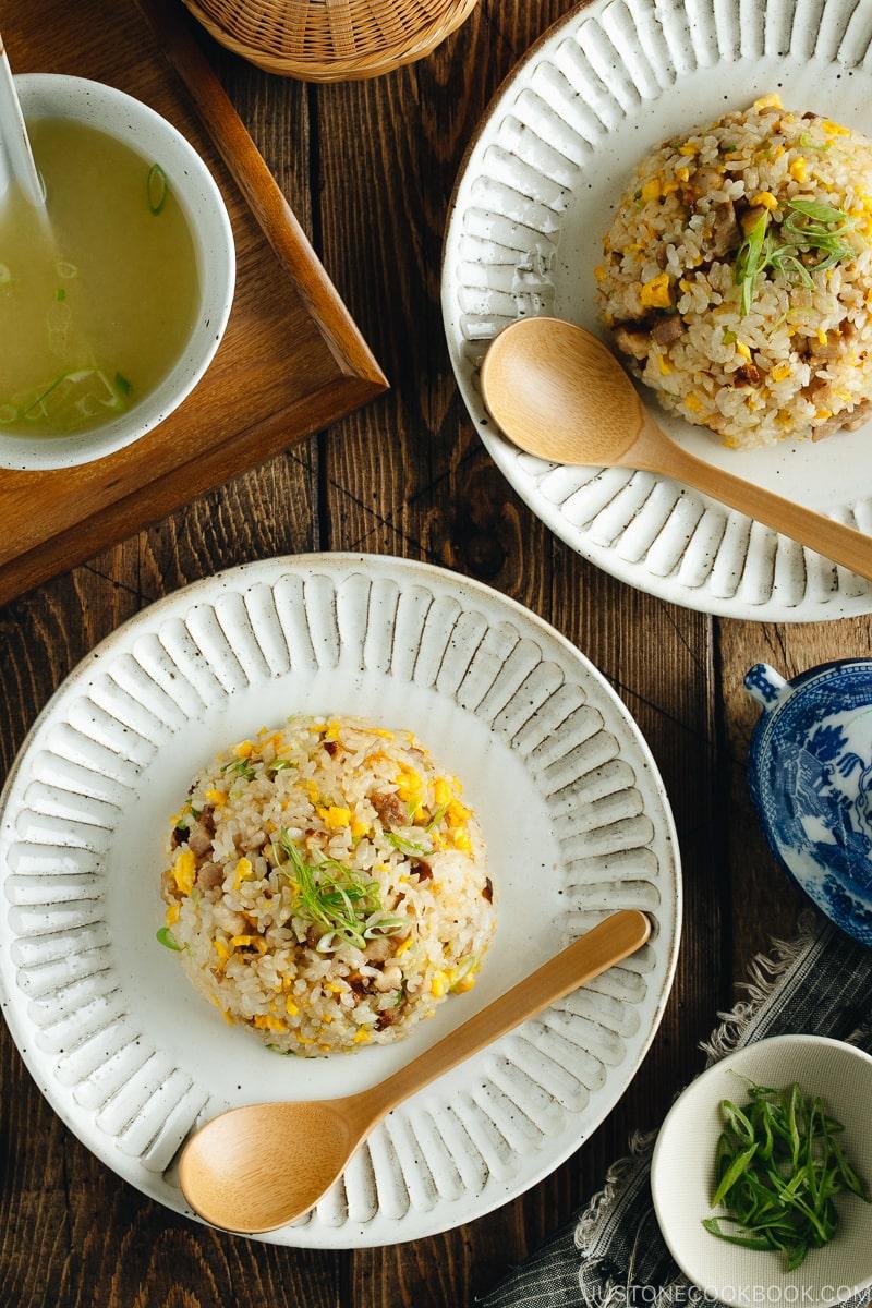 Chashu fried rice on white plates.