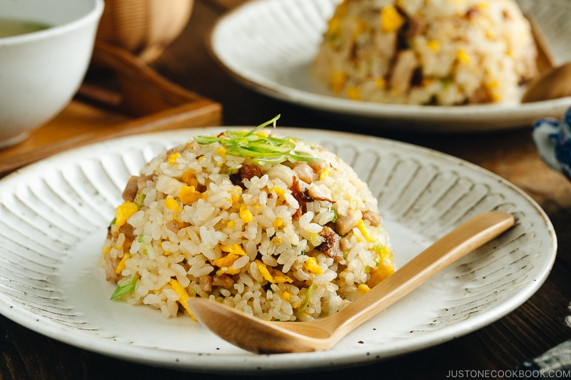 Chashu fried rice served on white plates.